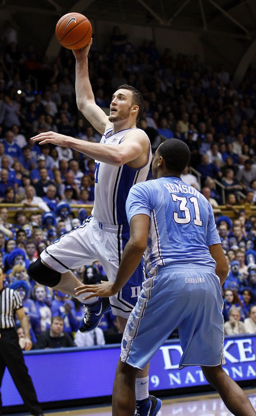 Duke's Miles Plumlee shoots as North Carolina's John Henson defends during the second half in Durham, N.C., on Saturday, March 3, 2012. North Carolina won 88-70. (AP Photo/Gerry Broome)