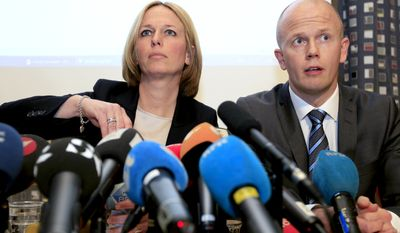 Prosecutors Inga Bejer Engh (left) and Svein Holden speak during a March 7, 2012, press conference in Oslo, where they unveiled the indictment against confessed mass killer Anders Behring Breivik. Breivik is expected to face terror charges for a bombing in downtown Oslo and a shooting massacre at a political party's youth camp. (Associated Press)