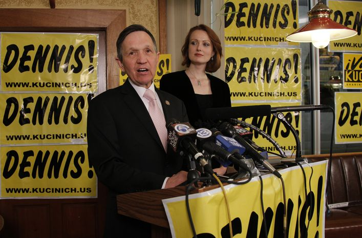 With his wife, Elizabeth, at his side, Rep. Dennis Kucinich, Ohio Democrat, addresses supporters at Rubin's Restaurant and Deli in Cleveland as the votes are tallied in his race against fellow Democratic Rep. Marcy Kaptur on Tuesday, March 6, 2012. (AP Photo/Amy Sancetta)