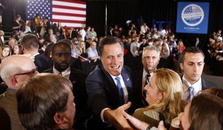 Republican presidential candidate and former Massachusetts Gov. Mitt Romney greets supporters March 6, 2012, at his Super Tuesday primary party in Boston. (Associated Press)