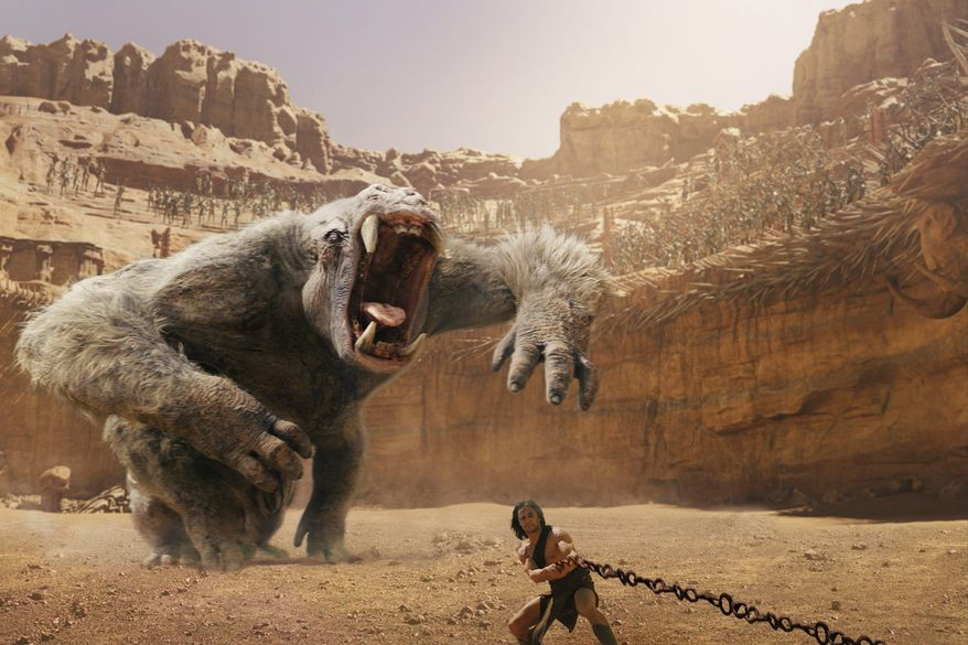 """John Carter"" sees Taylor Kitsch transported to Mars where he leads the resident Thark people against an invader. (Disney via Associated Press)"