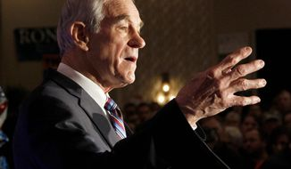 Republican presidential candidate Ron Paul, addressing in a crowd in North Dakota on Tuesday, is banking on winning over delegates in states where straw-poll and caucus results are not binding. His supporters will be contacting those delegates. (Associated Press)