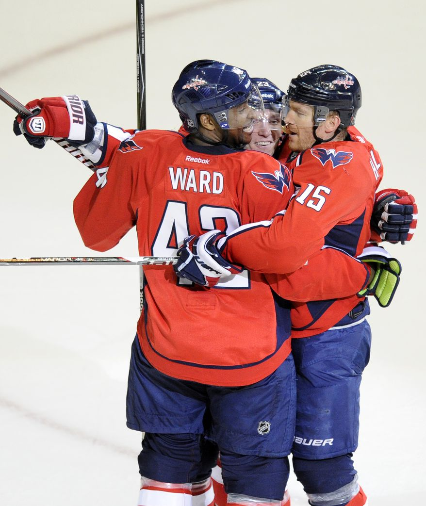 Washington Capitals center Keith Aucoin celebrates his goal with teammates Joel Ward and Jeff Halpern during the first period against the Tampa Bay Lightning on Thursday, March 8, 2012, in Washington. (AP Photo/Nick Wass)