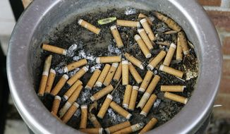 **FILE** An ashtray full of cigarette butts is shown in Omaha, Neb., on March 28, 2007. (Associated Press)