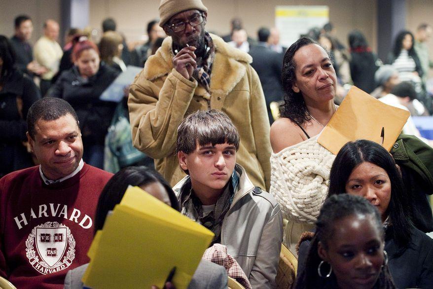 Job seekers attend a National Career Fair in New York on Wednesday, Feb. 22, 2012. (AP Photo/Mark Lennihan)