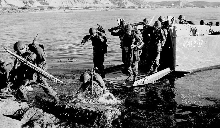 Troops of the 1st U.S. Cavalry Division land ashore at Pohang on the east coast of Korea in July 1950 during the Korean War. (AP Photo, File)