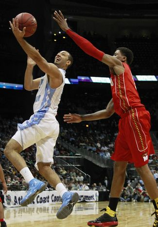 North Carolina guard Kendall Marshall heads to the basket as Maryland guard Nick Faust defends during the first half in the quarterfinals of the ACC tournament, Friday, March 9, 2012, in Atlanta. (AP Photo/John Bazemore)
