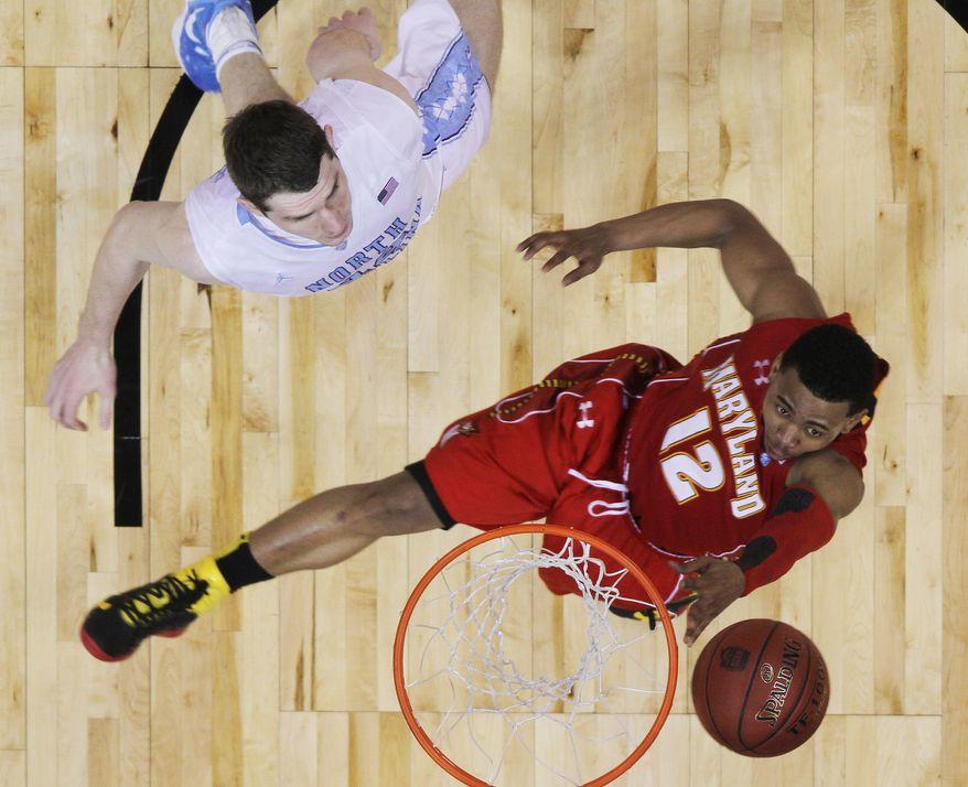 Maryland guard Terrell Stoglin shoots as North Carolina forward Tyler Zeller defends during the second half of the ACC tournament quarterfinals, Friday, March 9, 2012, in Atlanta. North Carolina won 85-69. (AP Photo/John Bazemore)