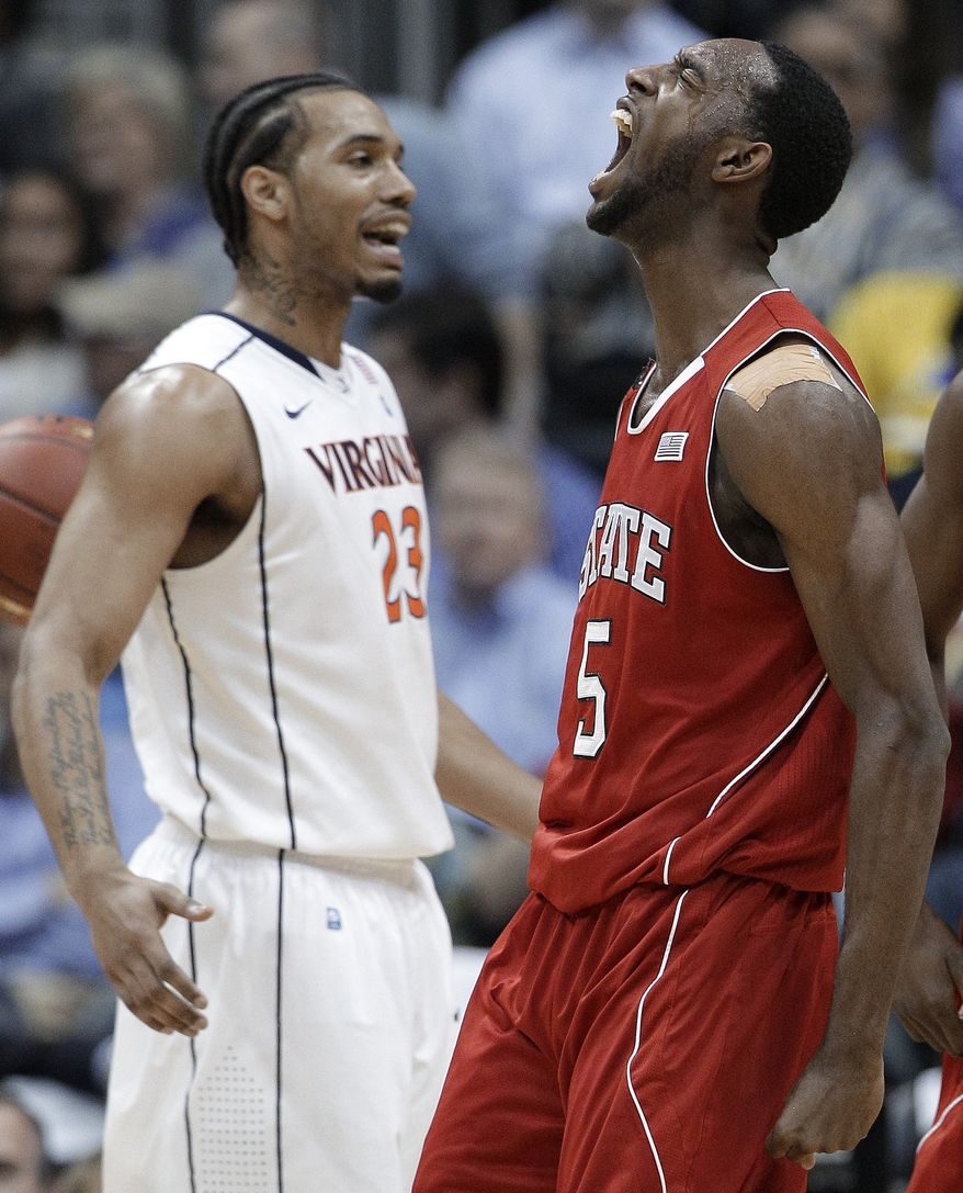 North Carolina State forward C.J. Leslie reacts after scoring as Virginia forward Mike Scott stands nearby during the first half in the quarterfinals of the ACC tournament, Friday, March 9, 2012, in Atlanta. (AP Photo/Chuck Burton)
