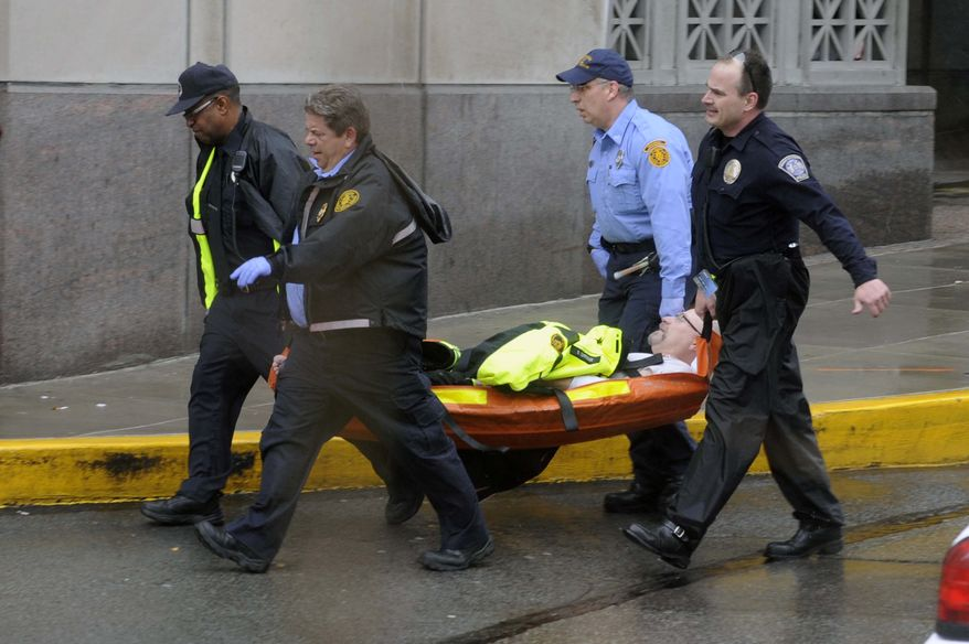 Police and paramedics carry a shooting victim from Western Psychiatric Institute and Clinic in Pittsburgh on March 8, 2012. A gunman opened fire at the clinic, killing two people, including the gunman. Seven others were wounded. (Associated Press/Pittsburgh Tribune-Review)
