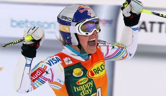 Lindsey Vonn celebrates at the finish line on March 9, 2012, after winning a women's Alpine Ski World cup giant slalom competition in Are, Sweden. (Associated Press)