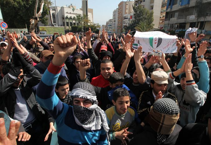 Anti-regime protesters chants slogans against Syrian President Bashar Assad during a demonstration on March 9, 2012, after Friday prayer in Beirut. (Associated Press)