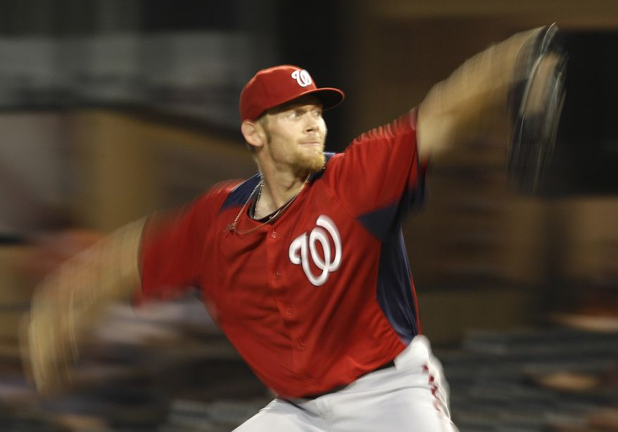 Washington Nationals starting pitcher Stephen Strasburg throws against the Miami Marlins in the second inning of a spring training game in Jupiter, Fla., Friday, March 9, 2012. (AP Photo/Patrick Semansky)