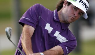 Bubba Watson chips onto the 18th hole green during the third round of the Cadillac Championship tournament on Saturday, March 10, 2012 in Doral, Fla. (AP Photo/Wilfredo Lee)