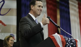 Former Pennsylvania Sen. Rick Santorum speaks during the Cape County Republican Women's Lincoln Day Dinner, Saturday, March 10, 2012, in Cape Giradeau, Mo. Rick Santorum won the Kansas caucuses in a rout on Saturday and Republican presidential front-runner Mitt Romney countered in Wyoming, a weekend prelude to suddenly pivotal Southern primary showdowns in the week ahead. (AP Photo/Eric Gay)