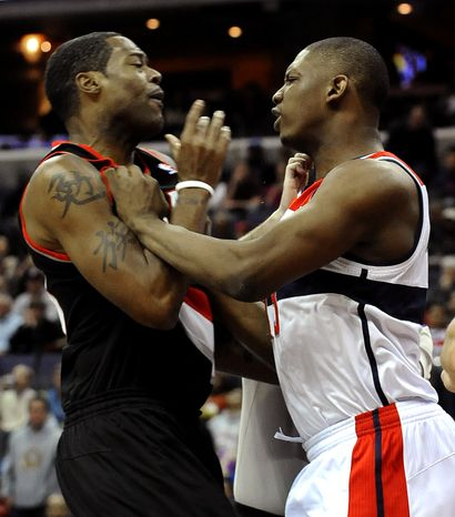 Washington Wizards' Kevin Seraphin pushes Portland Trail Blazers' Marcus Camby as the two scuffle under the basket during first half on Saturday, March 10, 2012, in Washington. Camby was ejected from the game and Seraphin received a technical foul. (AP Photo/Richard Lipski)