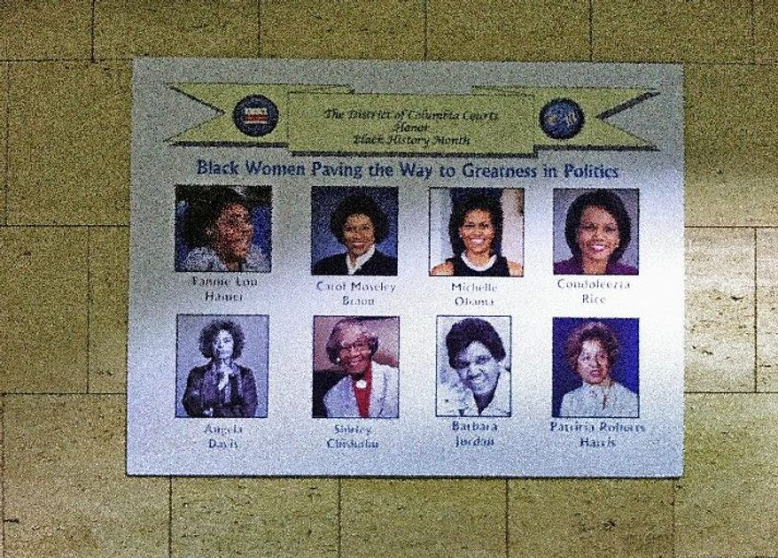"""A poster hanging on the wall in the D.C. Superior Court building in Washington, D.C. shows """"Black Women Paving the Way to Greatness in Politics."""" It curiously includes Ms. Davis. (The Washington Times)"""