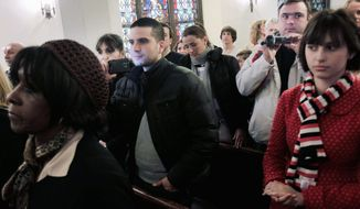 Tourists surreptitiously record video and photos during a church service at the Mother African Methodist Episcopal Zion Church in New York. The soulful gospel music has attracted visitors from around the world. (Associated Press)