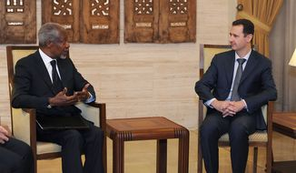 Syrian President Bashar Assad (right) meets with former U.N. Secretary-General Kofi Annan, the world body's special envoy to Syria, in Damascus, Syria, on Saturday, March 10, 2012. (AP Photo/SANA)