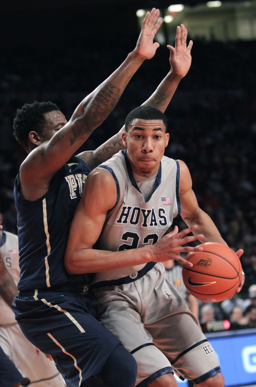 Georgetown's Otto Porter pushes past Pittsburgh's Nasir Robinson during the second round of the Big East tournament in New York, Wednesday, March 7, 2012. (AP Photo/Seth Wenig)