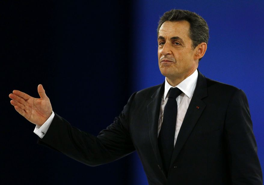 French President Nicolas Sarkozy waves after a re-election campaign speech in Villepinte, France, north of Paris, on Sunday, March 11, 2012. (AP Photo/Francois Mori)