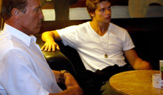 "** FILE ** This Thursday Oct. 6, 2011, file photo, shows Austrian-born actor and former Californian governor Arnold Schwarzenegger, left, and his son Patrick, right, sitting in a coffee bar in Graz, Austria. Partick Schwarzenegger, now 18, said Saturday, March 10, 2012, that he has been treated for injuries after getting in ""a little ski accident"" in Idaho. (AP Photo/DAPD, Markus Leodolter, File)"