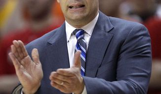 Virginia head coach Tony Bennett reacts after a play against Maryland in the second half in College Park, Md., Sunday, March 4, 2012. Virginia won 75-72 in overtime. (AP Photo/Patrick Semansky)