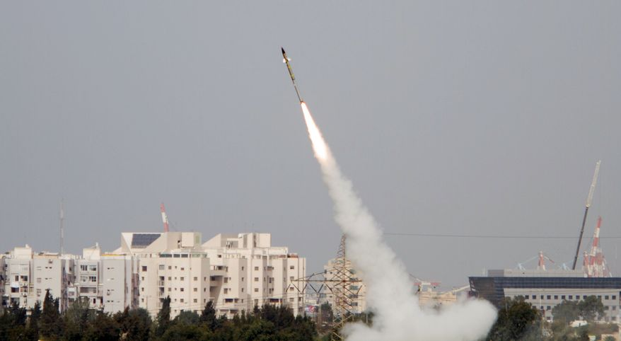 The Iron Dome is an Israeli-made system designed to shoot down short-range rockets such as those fired from the Gaza Strip. Here, a rocket is launched from southern Israel to intercept rockets fired by Palestinian militants in Gaza on Monday. (Associated Press)
