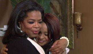 Oprah Winfrey comforts Bobbi Kristina Brown, who recalls the strong bond and devastating death of her mother, singer Whitney Houston, in an interview that aired Sunday on the OWN network. (Harpo Inc. via Associated Press)