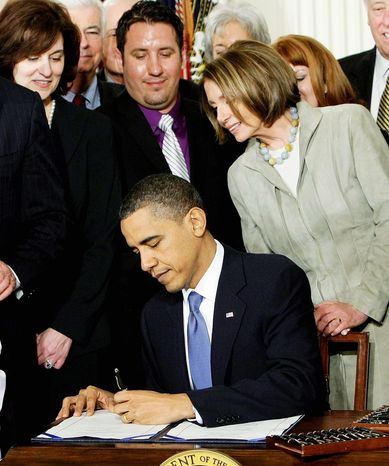 House Speaker Nancy Pelosi was one of the dignitaries on hand as President Obama signed the Affordable Care Act on March 23, 2010. The Supreme Court will start hearing arguments on the law's insurance mandate on March 26. (Associated Press)
