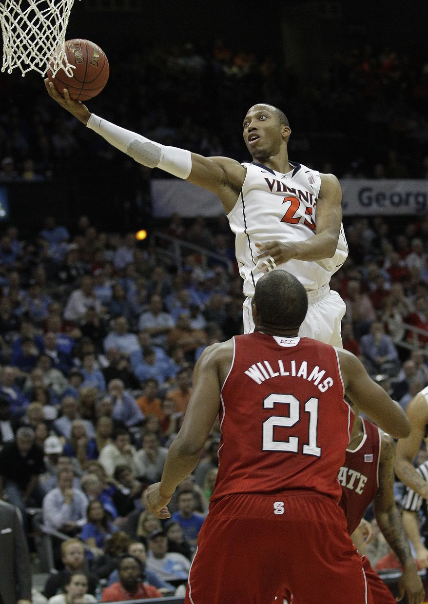 Virginia forward Mike Scott (23) shoots against N.C. State guard/forward C.J. Williams in the quarterfinals of the ACC tournament. The Cavaliers are now getting ready for their first trip to the NCAA tournament since 2007. (AP Photo/Chuck Burton)