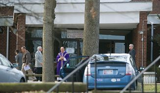 On Sunday, March 4, 2012, a priest stands outside St. John Neumann Catholic Church in Gaithersburg, the church where Barbara Johnson was recently denied communion at her mother's funeral because she is a lesbian. (Barbara L. Salisbury/The Washington Times)