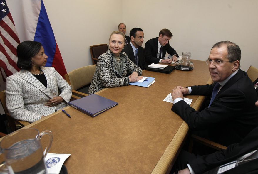 U.S. Secretary of State Hillary Rodham Clinton (center), accompanied by U.S. Ambassador to the United Nations Susan Rice and Russian Foreign Minister Sergei Lavrov, poses for photos at the beginning of their bilateral meeting at United Nations headquarters on March 12, 2012. (Associated Press)