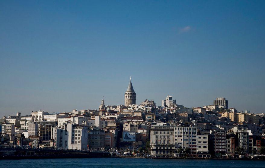 The skyline of Istanbul, Turkey's largest city, rises above the Bosporus. (AP Photo)