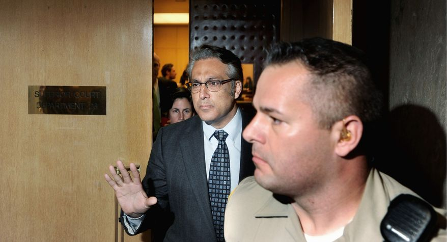 San Francisco Sheriff Ross Mirkarimi (left) leaves court Monday after pleading guilty to a misdemeanor charge of false imprisonment. He could still be ousted by the city's Board of Supervisors. (Associated Press)