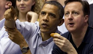 President Barack Obama and Britain Prime Minister David Cameron attend the Mississippi Valley State game against Western Kentucky in a first round NCAA tournament basketball game, Tuesday, March 13, 2012, at University of Dayton Arena, in Dayton, Ohio. (AP Photo/Carolyn Kaster)
