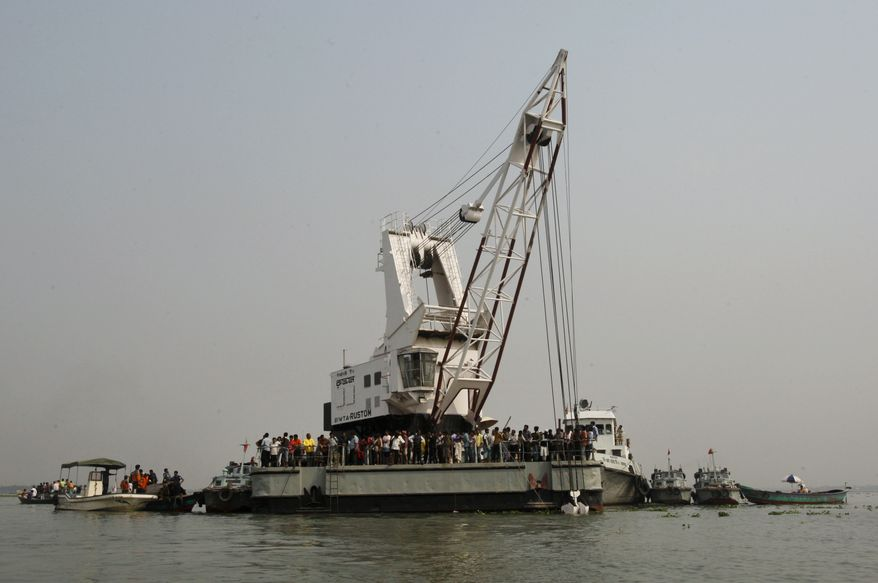 Rescuers search for victims of a ferry accident March 13, 2012, on the Meghna River in Munshiganj district, about 20 miles (32 kilometers) south of Dhaka, India. The ferry, packed with about 200 people, capsized in the river in southern Bangladesh, killing 31 people and leaving dozens more missing, authorities said. (Associated Press)