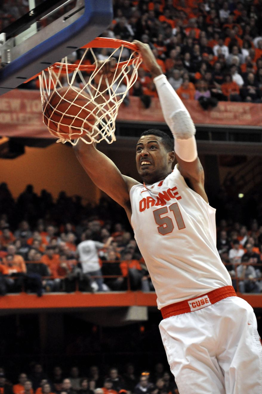 ** FILE ** In this Jan. 14, 2012, file photo, Syracuse's Fab Melo dunks against Providence. Melo did not travel with the team to Pittsburgh and the university says he won't take part in the NCAA tournament because of an eligibility issue. The school would not elaborate. (AP Photo/Kevin Rivoli, File)