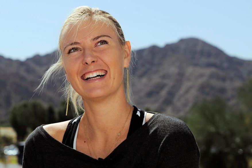 Maria Sharapova, of Russia, laughs while being interviewed at the BNP Paribas Open tennis tournament, Wednesday, March 7, 2012, in Indian Wells, Calif. (AP Photo/Mark J. Terrill)