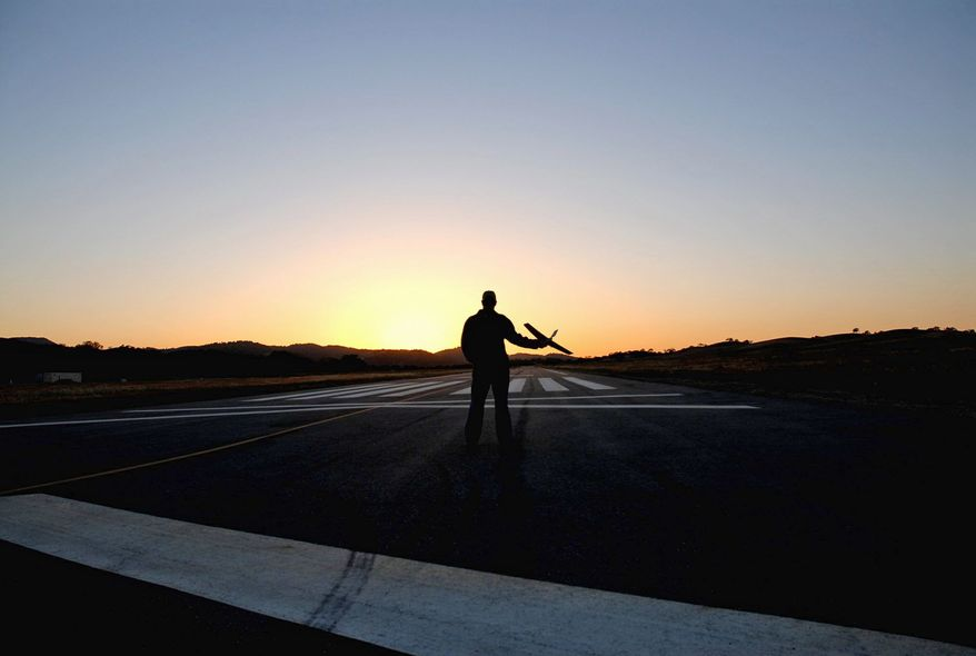 The hand-held Wasp drone needs no runway. Drones can be the size of jetliners or Frisbees. (Aerovironment Inc.)