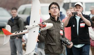 Jordi Munoz holds drone he made himself. (Courtesy of Jordi Munoz)