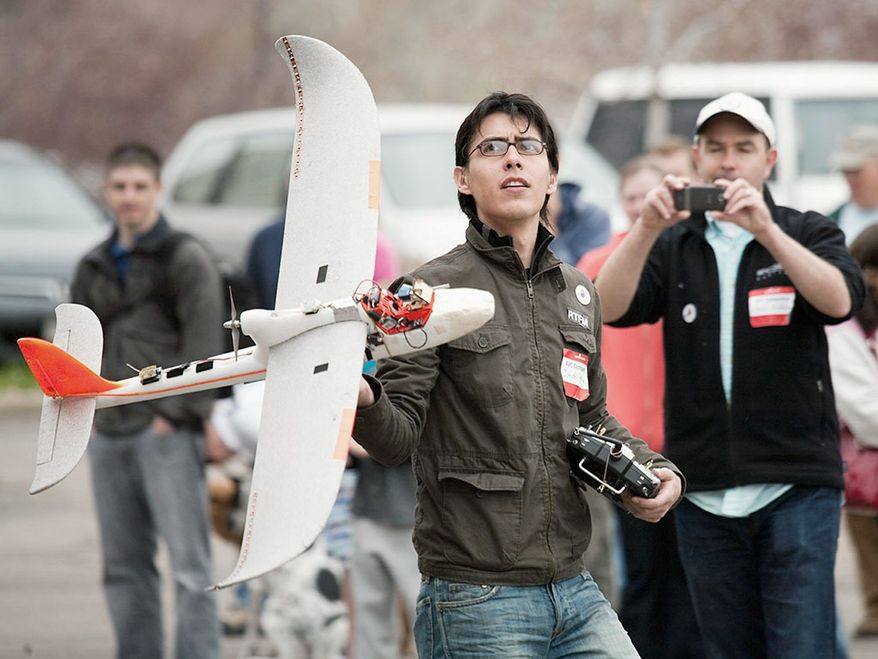 Jordi Munoz holds drone he made himself. (Courtesy of Jordi Munoz)