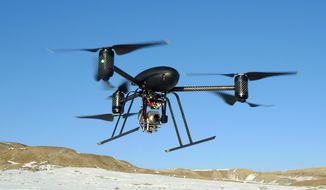 A Draganflyer X6 drone lent to the Mesa County, Colo., Sheriff's Department in 2009 is used in search-and-rescue, finding suspects and identifying fire hot spots. (Mesa County Sheriff's Department via Associated Press)