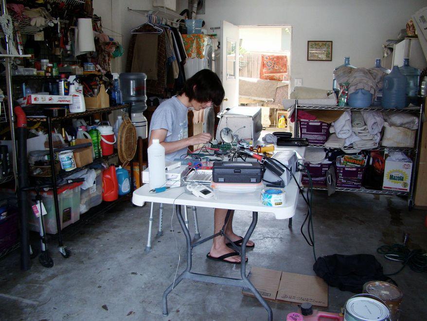 Jordi Munoz works on a drone in his garage. (Courtesy of Jordi Munoz)