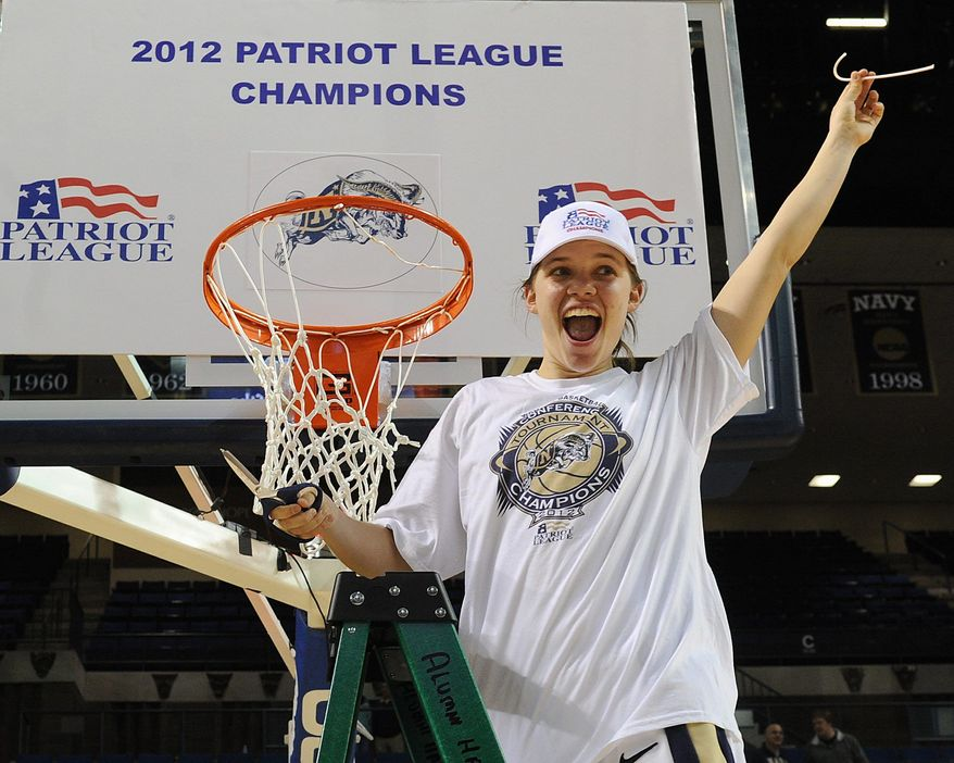 Audrey Bauer cuts down the hoop after the Naval Academy won the 2012 Patriot League Championship. (Navy Athletics)