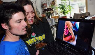 "Loriann Earp cries with her husband, Justin, while viewing photos of their daughter, Ashley Long, who died Feb. 18 at age 14 after inhaling helium. ""Inhaling helium starves the brain and other body organs of oxygen,"" said Rose Ann Soloway, a clinical toxicologist at the National Capital Poison Center. (Associated Press)"