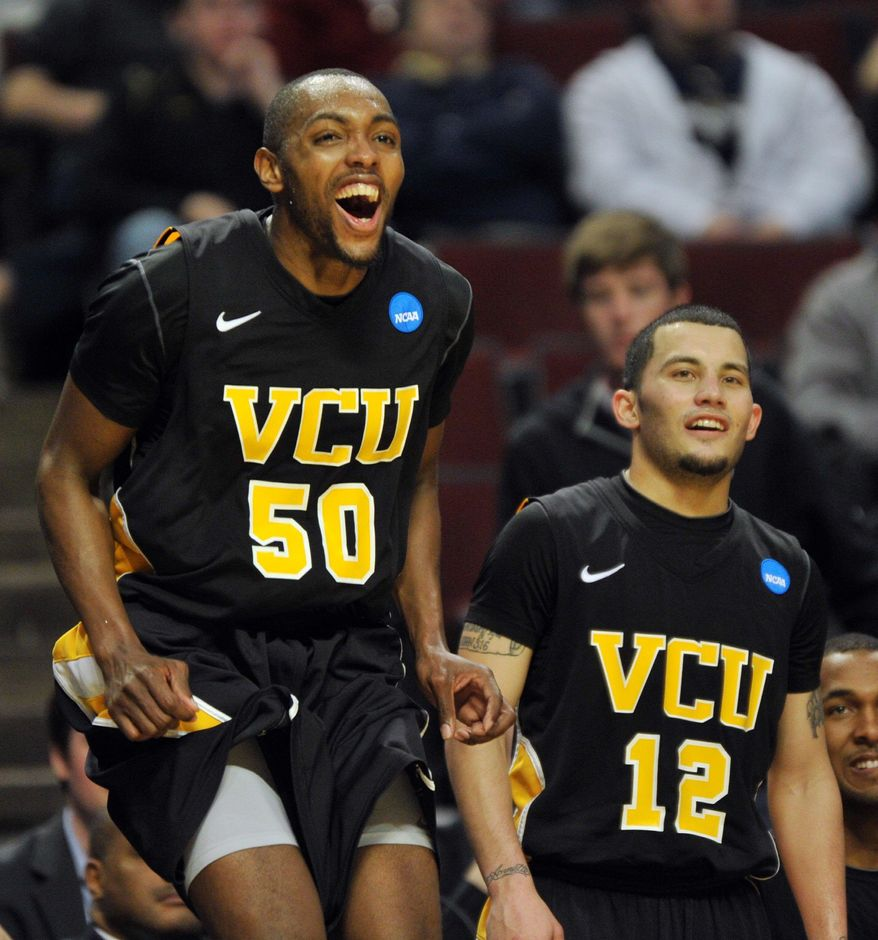 Last year, Virginia Commonwealth's Ed Nixon (50) and Joey Rodriguez found themselves celebrating a 74-56 triumph over Georgetown in the round of 64 of the NCAA tournament. (Associated Press)
