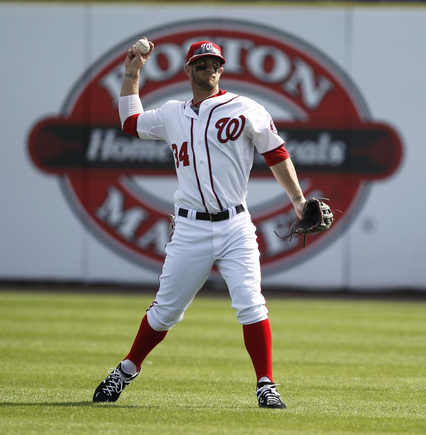 Washington Nationals' Bryce Harper made his spring training debut in center field against the Atlanta Braves on Wednesday.  (AP Photo/Julio Cortez)