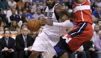 Dallas Mavericks' Vince Carter (25) and Washington Wizards' Trevor Booker, right, during an NBA basketball game Tuesday, March 13, 2012, in Dallas. The Mavericks won 107-98. (AP Photo/Tony Gutierrez)
