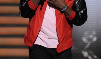 "** FILE ** In this March 7, 2012, file photo released by Fox, contestant Jermaine Jones performs on the singing competition series ""American Idol,"" in Los Angeles. (AP Photo/Fox, Michael Becker, File)"